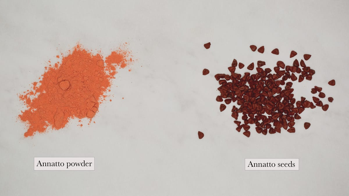 annatto powder and annatto seeds side by side