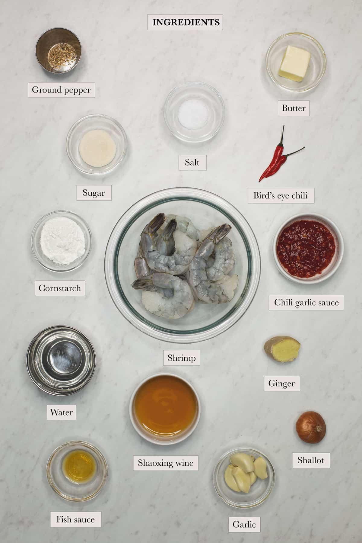 ingredients include ground pepper, butter, sugar, salt, Bird's eye chili, cornstarch, shrimp, chili garlic sauce, water, Shaoxing wine, ginger, fish sauce, garlic, and shallot