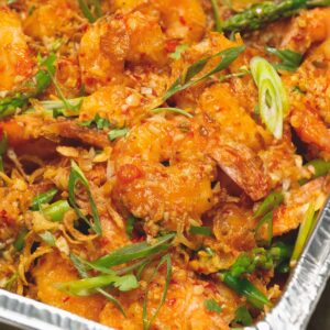 Asian chili garlic shrimp in a foil pan