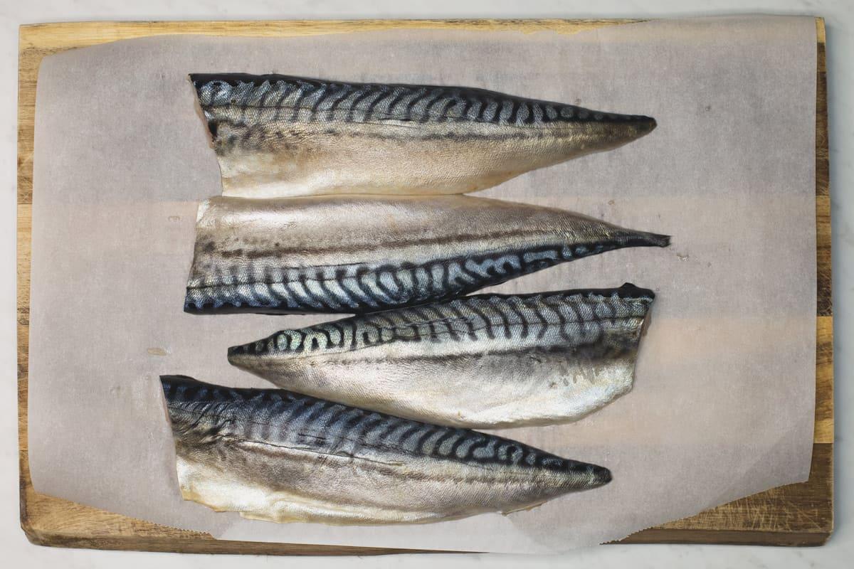 mackerel fillets on a cutting board