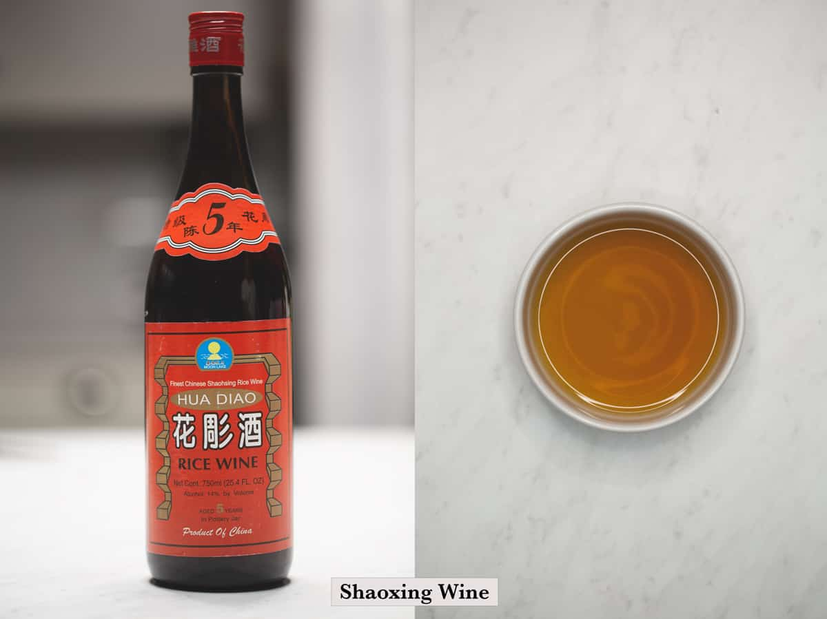 Shaoxing wine bottle and shaoxing wine on a small white bowl