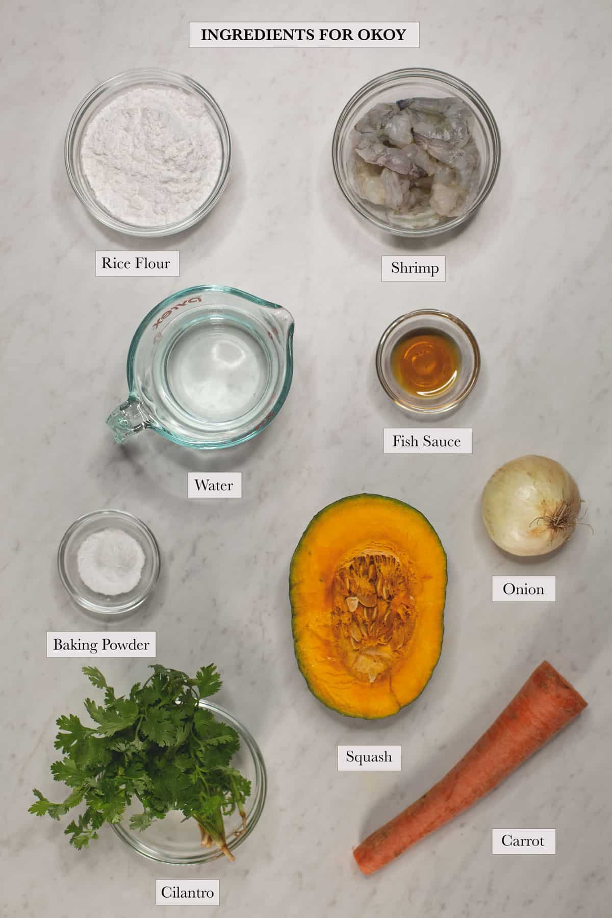 Ingredients for okoy include rice flour, shrimp, water, fish sauce, baking powder, squash, onion, cilantro, and carrot.