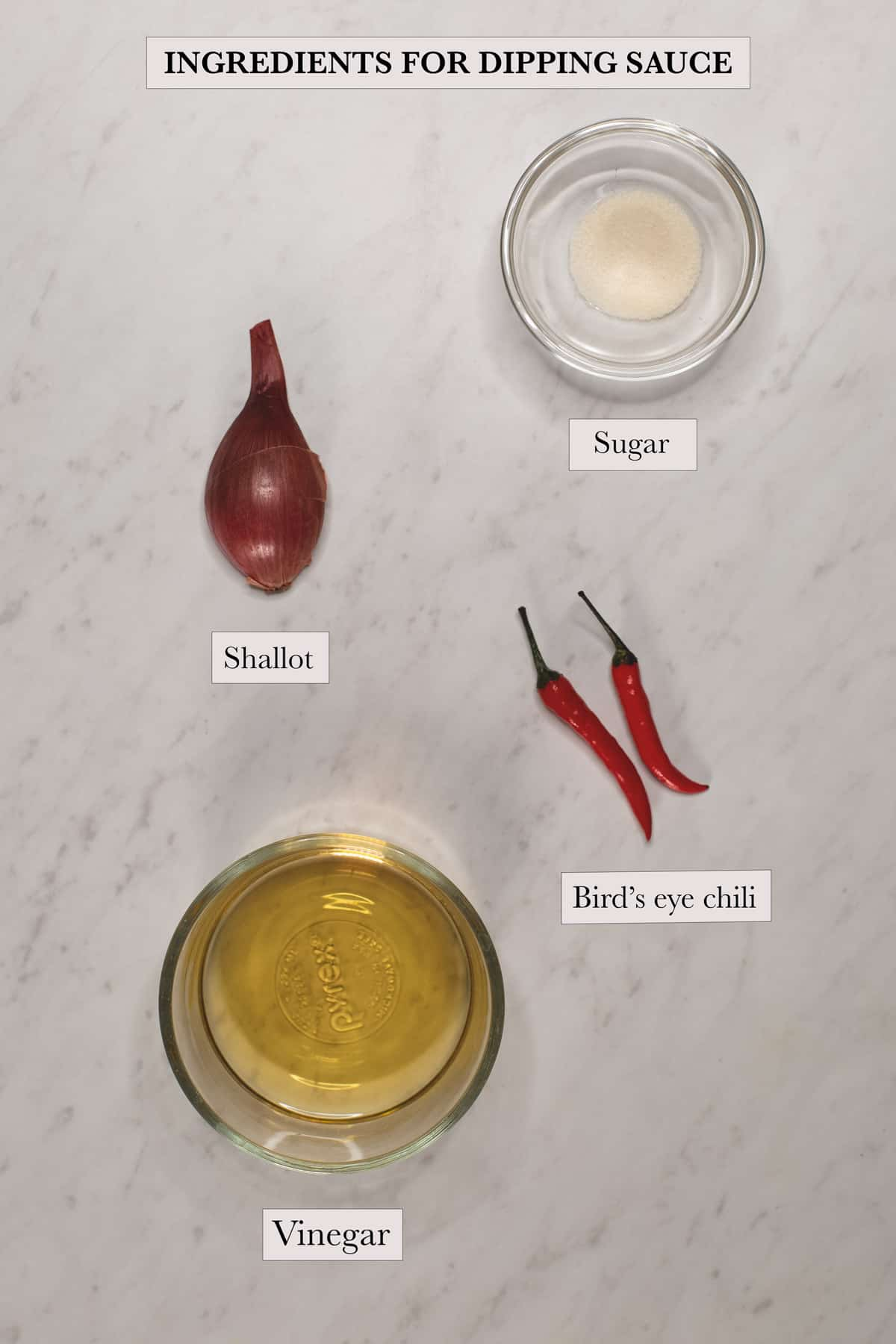 ingredients for the dipping sauce include shallot, sugar, bird's eye chili, and vinegar.