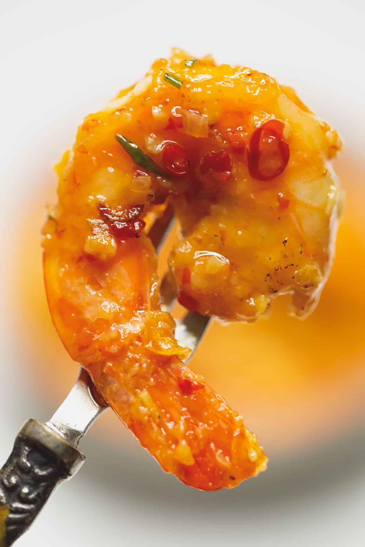 saucy piece of shrimp on a fork