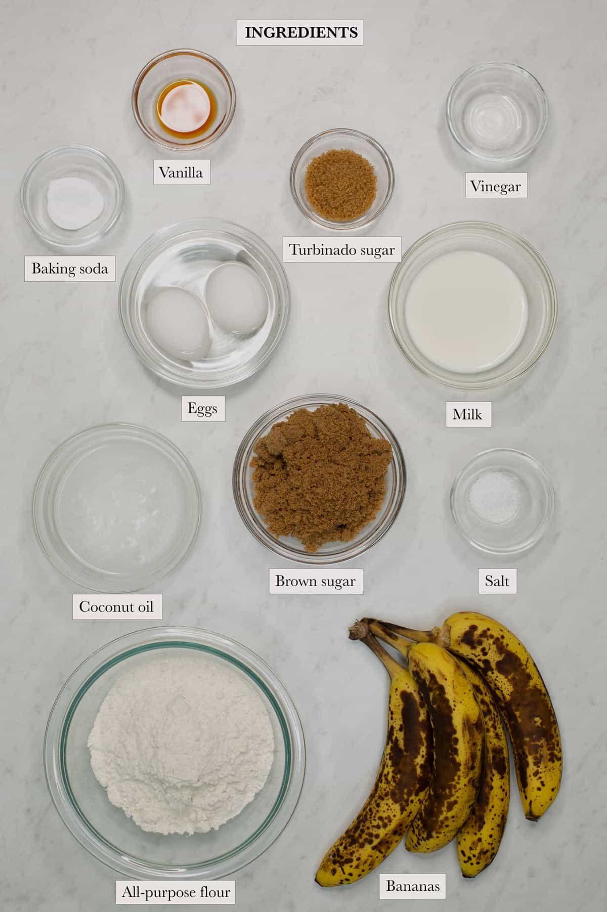 Ingredients include bananas, all-purpose flour, coconut oil, brown sugar, salt, milk, vinegar, eggs, baking soda, vanilla, and turbinado sugar.